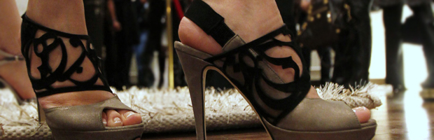 A model displays a shoe creation by designer Aennis Eunis in Amman