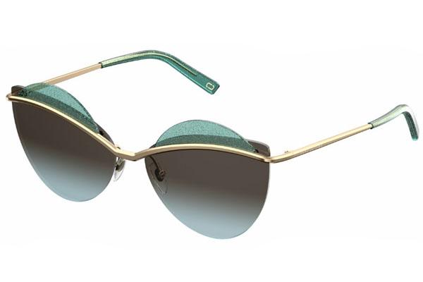 Estas gafas de Marc Jacobs combinan líneas arquitectónicas y materiales mezclados para crear un efecto de lentes flotantes en capas.