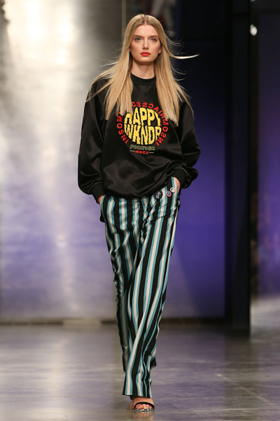 A model presents a creation by Versus (Versace) during a catwalk show
