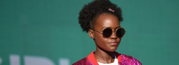 """(FILES) This file photo taken on September 23, 2017 shows Lupita Nyong'o speaking onstage during the 2017 Global Citizen Festival in Central Park to End Extreme Poverty by 2030 at Central Park in New York City. Kenyan actress Lupita Nyong'o, who won an Oscar for her role in """"12 Years a Slave"""", on November 10, 2017, complained her hair had been airbrushed out of a picture on the front cover of women's magazine Grazia UK. / AFP / ANGELA WEISS   FILES-BRITAIN-FILM-RASCISM"""