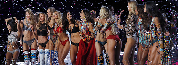 Models of the Victoria's Secret Fashion Show cheer each other on stage during the Victoria's Secret fashion show at the Mercedes-Benz Arena in Shanghai, China, Monday, Nov. 20, 2017. (AP Photo/Andy Wong) APTOPIX China Victoria Secret