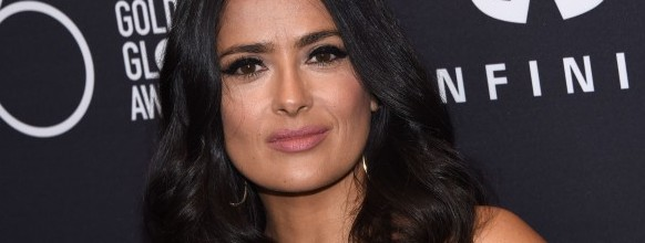 """(FILES) This file photo taken on November 15, 2017 shows actress Salma Hayek attending the Hollywood Foreign Press Association (HFPA) and InStyle celebration of the 75th Annual Golden Globe Awards season at Catch LA in  West Hollywood. A-lister Salma Hayek on December 13, 2017 joined the scores of actresses to accuse Harvey Weinstein, alleging that the fallen Hollywood mogul sexually harassed her, subjected her to escalating rage and once threatened to kill her.""""For years, he was my monster,"""" the Mexican-born star wrote in an essay published in The New York Times, detailing the torturous production of the 2002 movie """"Frida"""" that eventually earned Hayek an Oscar nomination for best actress.   / AFP / CHRIS DELMAS   FILES-ENTERTAINMENT-US-HARASSMENT-WEINSTEIN-HAYEK-MEXICO"""