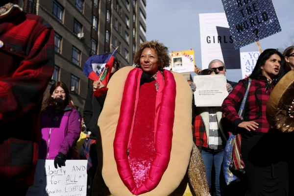 A woman marches in a costume during the Women's March in Manhattan in New York