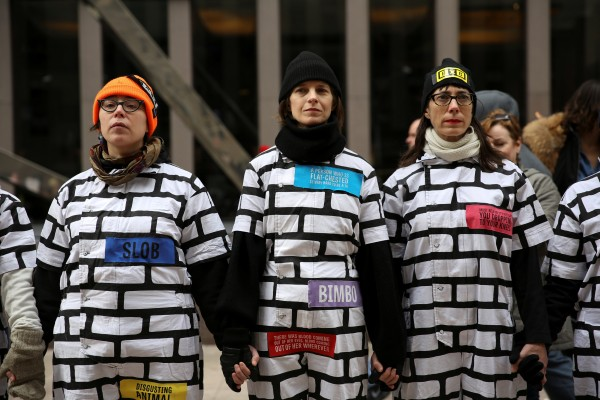 Members of Brick x Brick, a public-art-performance group stand dressed as a brick wall during the Women's March in Manhattan in New York City,