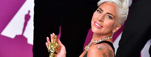 """Best Original Song winner for """"Shallow"""" from """"A Star is Born"""" Lady Gaga poses in the press room with the Oscar during the 91st Annual Academy Awards at the Dolby Theatre in Hollywood, California on February 24, 2019.  / AFP / FREDERIC J. BROWN   US-OSCARS-PRESSROOM"""