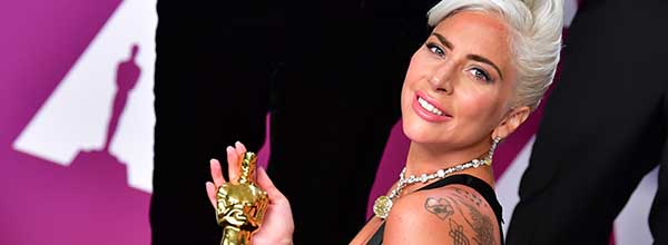 "Best Original Song winner for ""Shallow"" from ""A Star is Born"" Lady Gaga poses in the press room with the Oscar during the 91st Annual Academy Awards at the Dolby Theatre in Hollywood, California on February 24, 2019.  / AFP / FREDERIC J. BROWN   US-OSCARS-PRESSROOM"